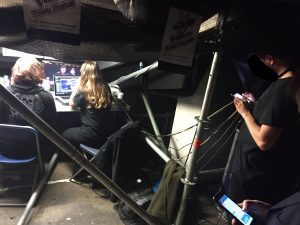Image of production staff on The Voice maintaining the show's social media feeds in a backstage area